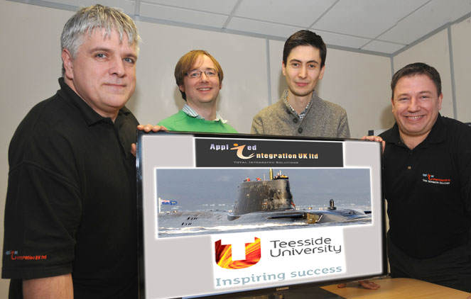 Applied Integration based in Stokesley have formed a new partnership with Teesside University. Pictured are Garry Lofthouse (right) and Lee Raywood (left)  from AI with Dr Peter Gregory (2nd left) & Dr Joao Ferrier (2nd right) of Teesside Uni. 8/1/15  Pic Doug Moody Photography